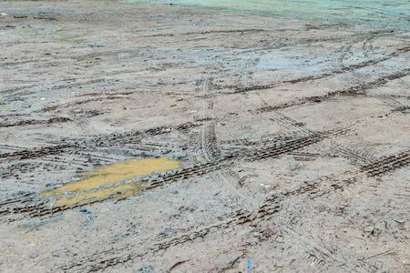 quagmire: Wheel tracks in outdoor carpark after raining. Stock Photo