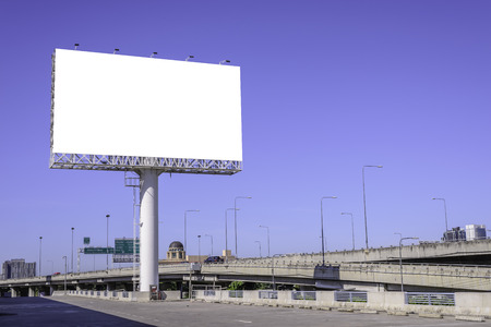 advertisement: Blank billboard against blue sky for advertisement.