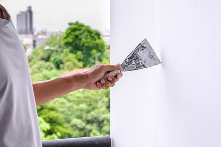 refurbishment: Wall refurbishment with plastering using putty knife.