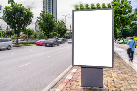 advertising text: Blank advertising panel near road at day time. Stock Photo