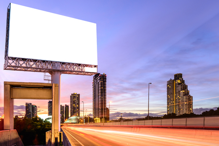 billboard advertising: Blank billboard on expressway at twilight for advertisement.