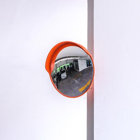 convex: Traffic convex mirror at car park. Stock Photo