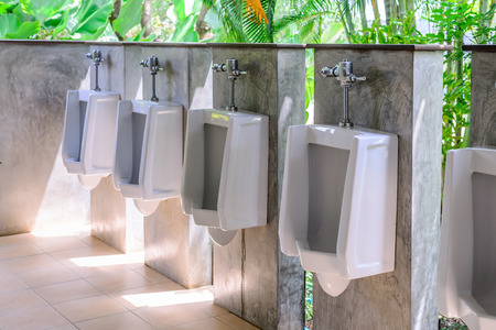 latrine: Row of uninals for men in good environment. Stock Photo