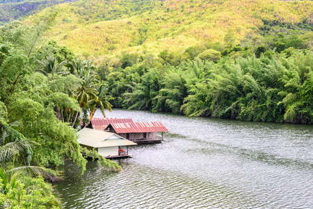 house float on water: Raft house in kwai river spring seasonal at Kanchanaburi, Thailand. Stock Photo