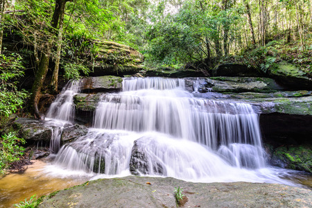 waterfall in the forest: Tham Yai Waterfall at Phu Kradueng national park in Loei, Thailand.