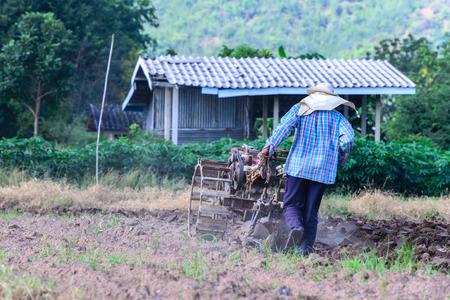 empleadas domesticas: Thai farmer using walking tractors for cultivated soil for prepare plantation.