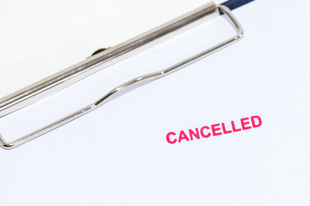 cancelled stamp: Red cancelled stamp on white paper with clipboard.
