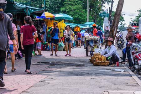 hawker: BANGKOK, THAILAND - 2015 October 23: Unidentified woman hawker selling handmade product at street side in Bangkok, Thailand. Editorial