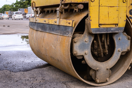 steamroller: Close up of heavy steamroller wheel at work site. Stock Photo