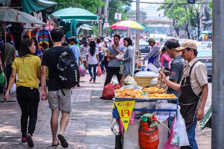 hawker: BANGKOK, THAILAND - 2015 October 23: Unidentified man hawker making fried treats for selling at street side in Bangkok, Thailand.