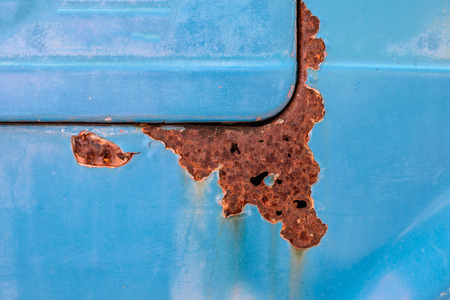 metal corrosion: Rusty and color scratched of old car.