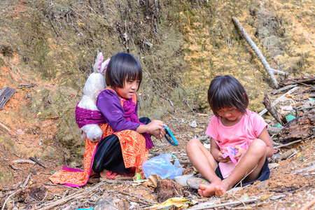 tribes: CHIANG MAI, THAILAND - 2015 November 04: Unidentify Lisu girls playing together, Lisu tribes live in northern of Thailand.