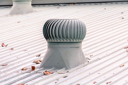 venting: Ventilation system on the roof of factory.
