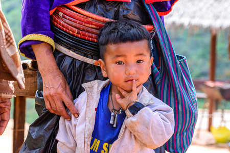 tribes: CHIANG MAI, THAILAND - 2015 November 05: Portrait of unidentify Palaung ragged boy, Palaung tribes live in northern of Thailand.