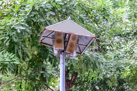 public address: Rusty speakers with rainproof roof for announcement broadcasting.
