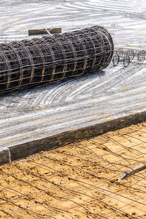 Meshing rebar for flooring with cement.