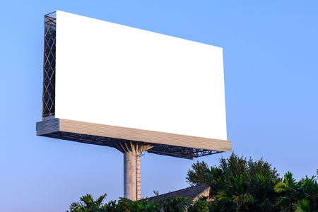 against: Blank billboard against blue sky for advertisement.