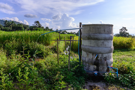 cataract: Water tank for plumbing system from cataract in countryside.