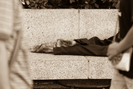 outcast: Homeless people sleeping at streetside in city, Black and white.