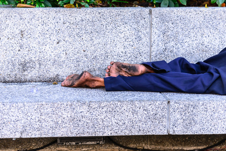 social outcast: Homeless people sleeping at streetside in city.