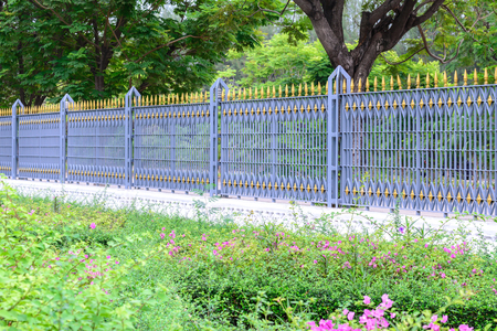 iron fence: Outside of metal fence public park protection.