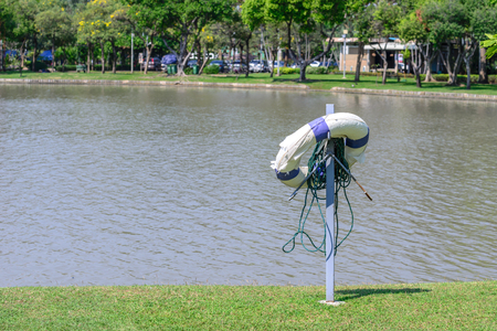 safety buoy: Life buoy for safety at urban pond.