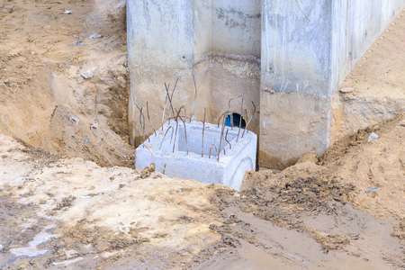 round rods: Pouring cement for building pole in construction site. Stock Photo