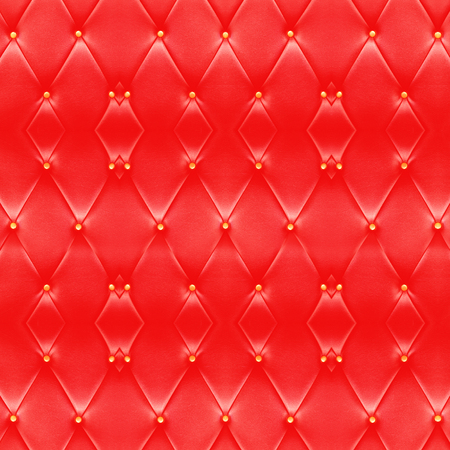 Beautiful red leather sofa with golden buttons use for background.