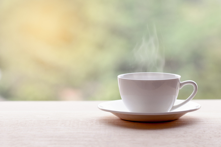 americano: Hot americano, Black coffee in white cup on wooden table. Stock Photo