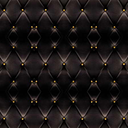 maroon leather: Texture of beautiful black leather sofa with golden buttons use for background.