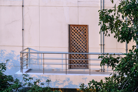 balcony design: Stainless balcony and wooden door of apartment.