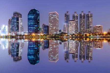 bangkok landmark: Bangkok skyline and water reflection with urban lake in summer.