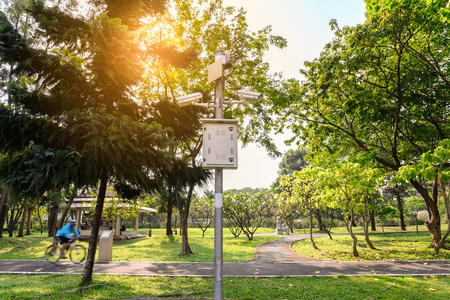 security monitor: Security IR camera for monitor events in urban park.