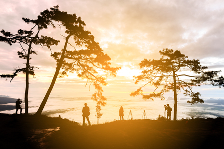 kradueng: Silhouette of photographers waiting for looking mist and sunrise at Phu Kradueng national park, Loei Thailand.
