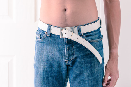 decreasing in size: Reduced waist to slim up man.
