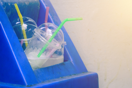 overflow: Overflow of drinking glass in trash can. Stock Photo