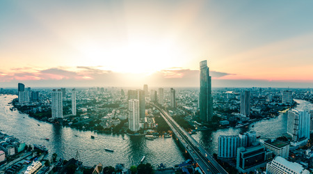 urbanscape: Panoramic view of Bangkok city riverfront skyline cityscape in Thailand.