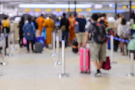 Queue of passengers check-in service at airport. Banco de Imagens