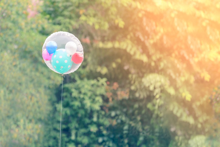 helium: Beautiful balloons contain helium gas with natural backgroun, warm tone.