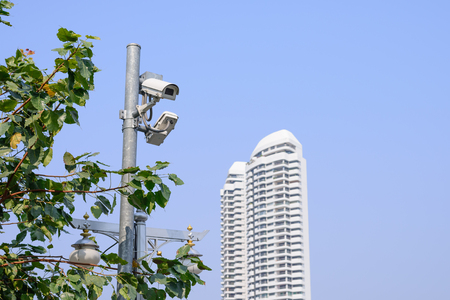 security monitor: Security camera for monitor events in city.