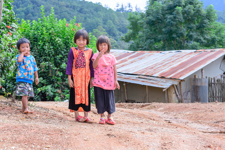 bamboo house: CHIANG MAI, THAILAND - 2015 November 04: Unidentified Lisu girls and boy standing together near old bamboo house, Lisu tribes live in northern of Thailand. Editorial