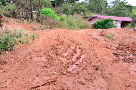 muddy: Muddy road in countryside village. Stock Photo