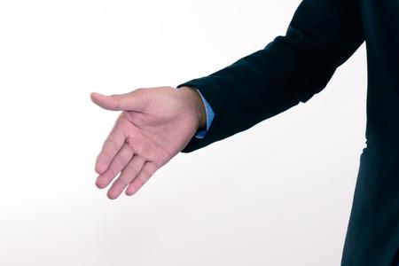 extending: Businessman extending hand to shake.
