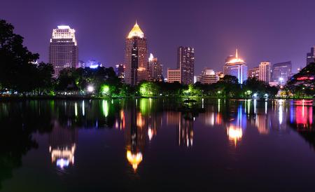 bangkok NIGHT: Bangkok night skyline and water reflection with urban lake in summer.