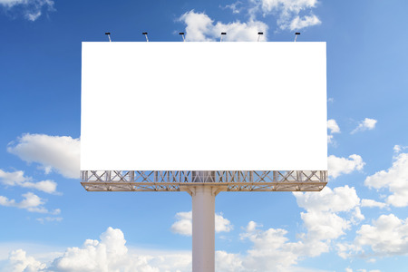 Blank billboard with blue sky and clouds for advertisement.