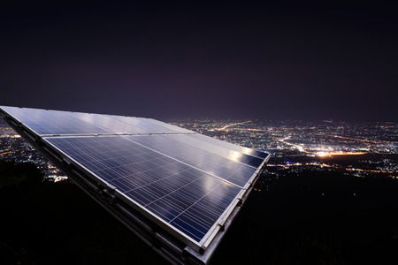 Solar panel with city night light. Standard-Bild