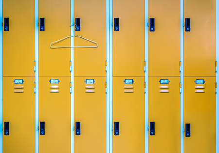 Close up of locker and clothes hanger. Stock Photo