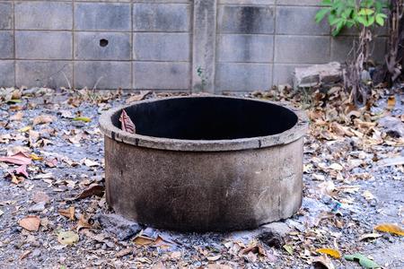 incinerator: DIY Concrete incinerator in rural. Stock Photo