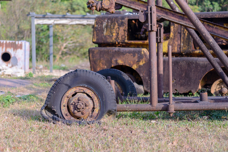 Aged truck rusted in abandoned mine.