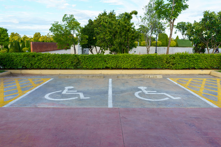 Wheelchair sign at car park reserved for cripple person.